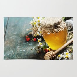 Honey and Herbal tea on wooden background Rug