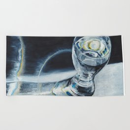 Glass of the water in the light Beach Towel