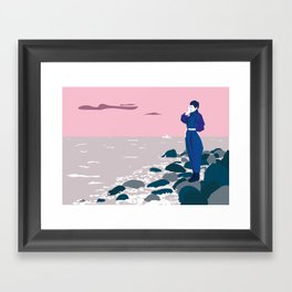 Woman by the sea Framed Art Print