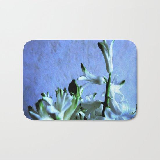 white hyacinthe on light blue background Bath Mat