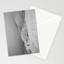 Walker on snow covered peaks. Mam Tor above Castleton, Peak District, Derbyshire, UK Stationery Cards