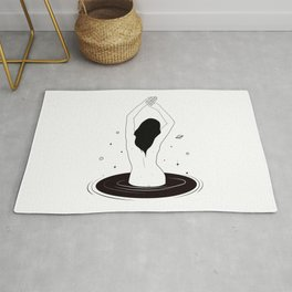 Woman in a black hole Rug