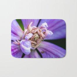Closeup of a blooming purple clematis flower Bath Mat