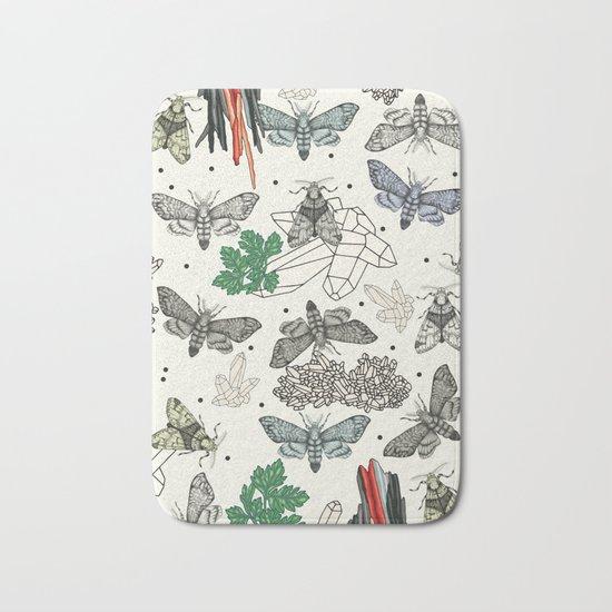 Moths and rocks. Bath Mat
