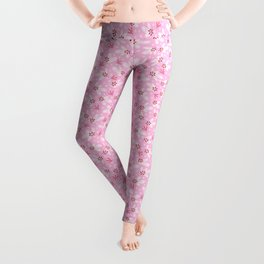 Pine branches, snowflakes and berries on pink Leggings