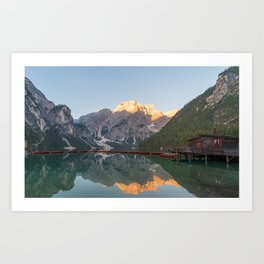The Seekofel mountains and wooden boats reflected in the waters of Lake Braies Art Print
