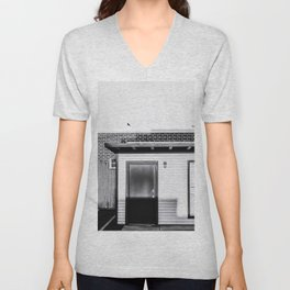 wood building with brick building background in black and white Unisex V-Neck
