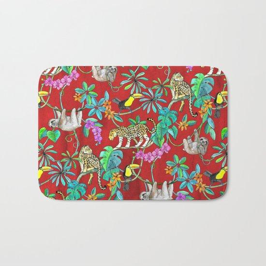 Rainforest Friends - watercolor animals on textured red Bath Mat