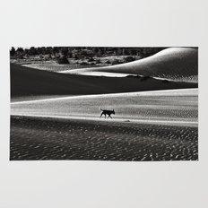 Walking alone through the desert of life Rug