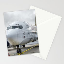 The plane at the airport on road Stationery Cards