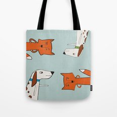 The fox and the hound look disgruntled at one another. Tote Bag