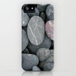 Pink rock on a grey beach iPhone Case
