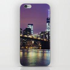 Manhattan Skyline over the Brooklyn Bridge at Night iPhone Skin