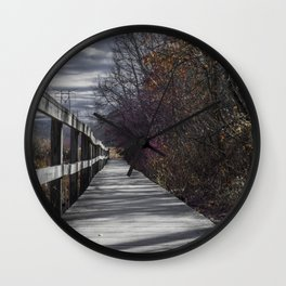 Extended wooden foot bridge through the forest Wall Clock