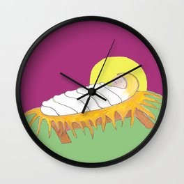 Jesus nestled in a manger wrapped in cloths Wall Clock