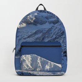 Snowy mountains. 3.478 meters Backpack