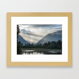 Bright contrast rays of morning sun over the Lake Matheson Framed Art Print