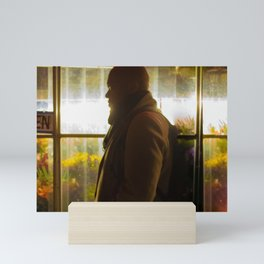 Man in front of Flowers Shop, A Mini Art Print
