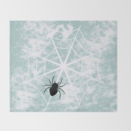 Spiderweb on a cloudy day Throw Blanket