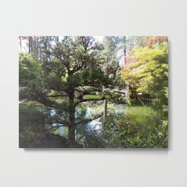 Peaceful Pond in Japanese Garden with Trees and a Bridge Metal Print