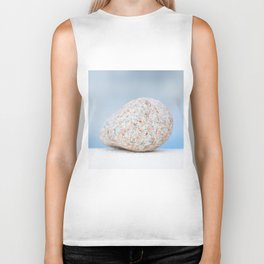 Granite pebble with blue water background Biker Tank