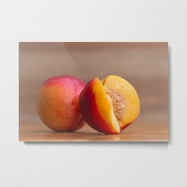Nectarines on wood Metal Print