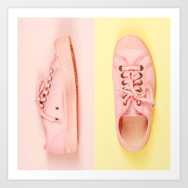 Pink canvas sneakers on pink and yellow  background, close up Art Print