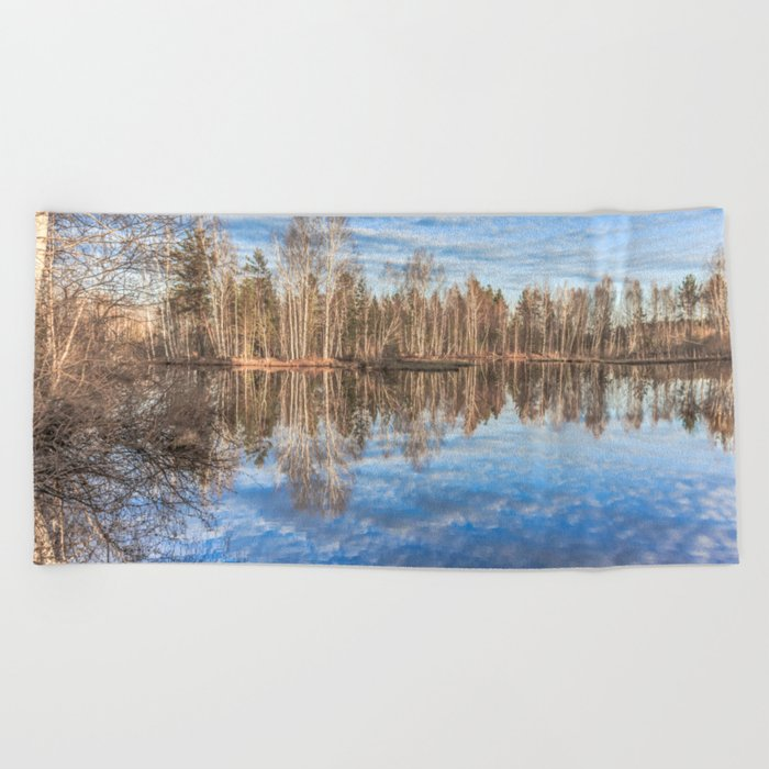Sky reflection in a spring pond Beach Towel