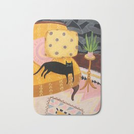 black cat on mustard yellow sofa painting by Tascha Bath Mat