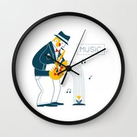 saxophone Wall Clocks featuring Man playing the saxophone by Wonderful Day