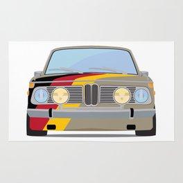 Old school car BMW with Germany flag Rug