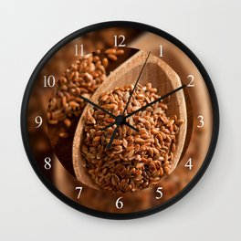 Brown linseeds portion on wooden spoon Wall Clock