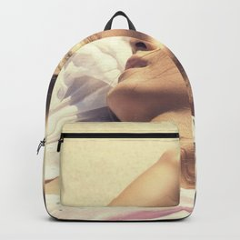Portrait of sexy beautiful woman lying in the sand Backpack