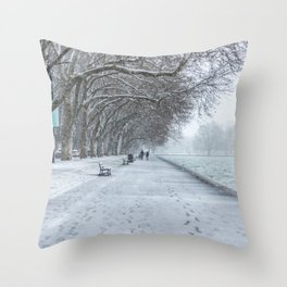 Leaving footprints under the cold freezing snow by the Lake Annecy in France Throw Pillow