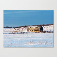 Barn gets a little glow from the Sun as it sits, waiting to be torn apart. Canvas Print