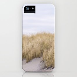 Field of grass growing in the sand iPhone Case