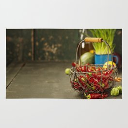 Hot red pepper and ingredients for cooking on rustic background Rug