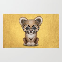 Cute Baby Lion Cub Wearing Glasses on Yellow Rug