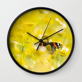 Orange butterfly in the middle of a marigolds field Wall Clock