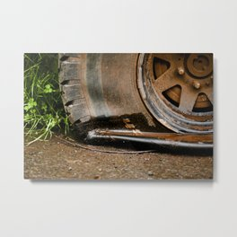 Old, flat brown tire Metal Print