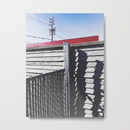 steel fence and wooden fence with red building in the city Metal Print