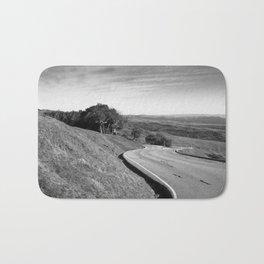 Winding road along the rolling hills near San Simeon, CA Bath Mat