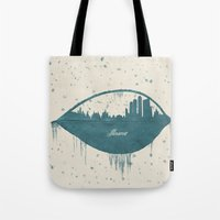 moscow Tote Bags featuring Frozen Moscow by Paula Belle Flores