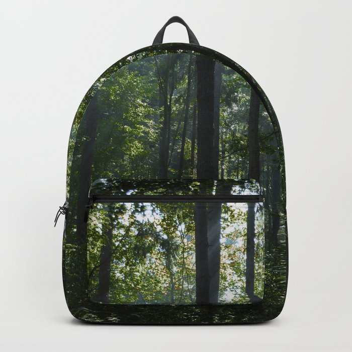 Green forest shrouded the sun. Backpack