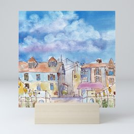 Colorful houses with little lamps in old town Mini Art Print