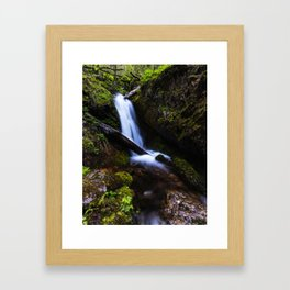 Waterfall in enchanted forest Framed Art Print