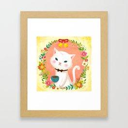 A cat who drinks tea Framed Art Print