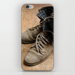 Pair of old leather shoes, worn-out and dusty, on wooden background iPhone Skin