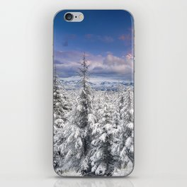 """""""Mountain light"""". Snowy forest at sunset iPhone Skin"""