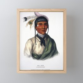 No-tin, a chief of the Ojibwa tribe, with facial tattoes and wearing a feather headdress. Coloured l Framed Mini Art Print